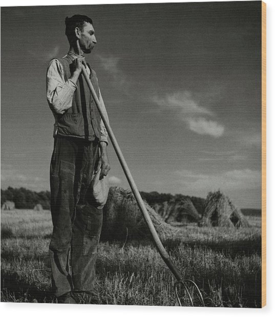 A Farmer Holding A Pitchfork Wood Print by Roger Schall