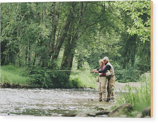 A Father And Daughter Fly Fishing Wood Print