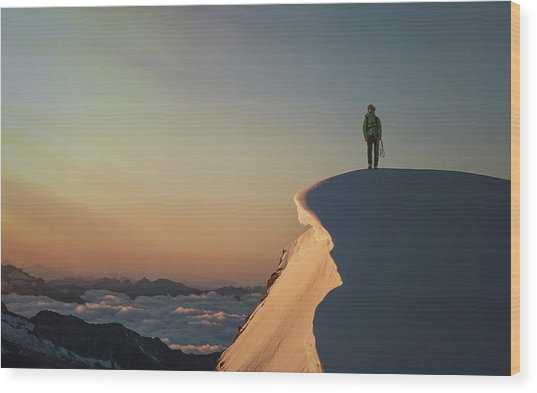 A Female Climber On A Snowy Mountaintop Wood Print by Buena Vista Images
