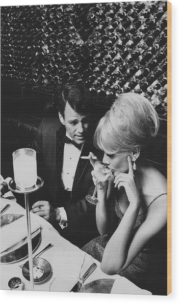 A Glamorous 1960s Couple Dining Wood Print