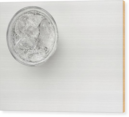 A Glass Of Sparkling Water With Ice Wood Print