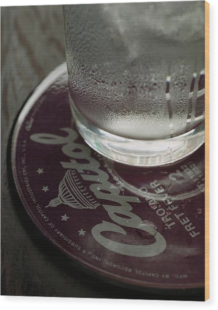 A Glass On A Coaster Wood Print by Romulo Yanes