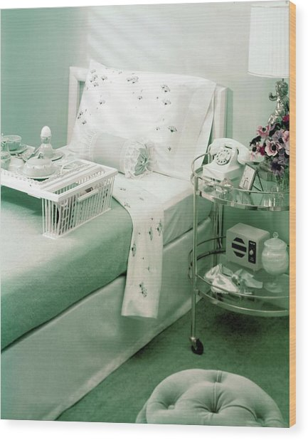 A Green Bedroom With A Breakfast Tray On The Bed Wood Print