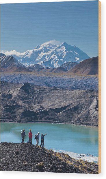 A Group Of Hikers Stand On Moraine Next Wood Print