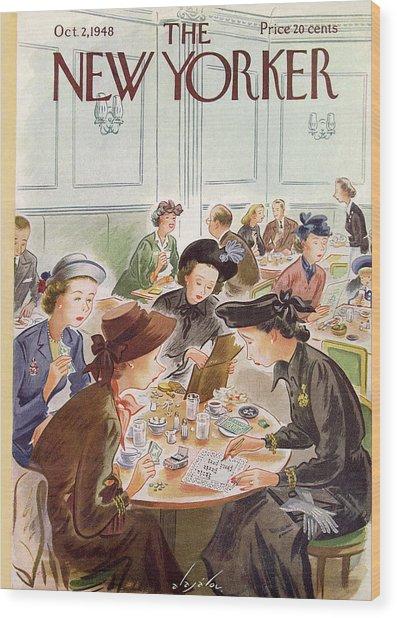 A Group Of Women Review A Dinner Receipt Wood Print