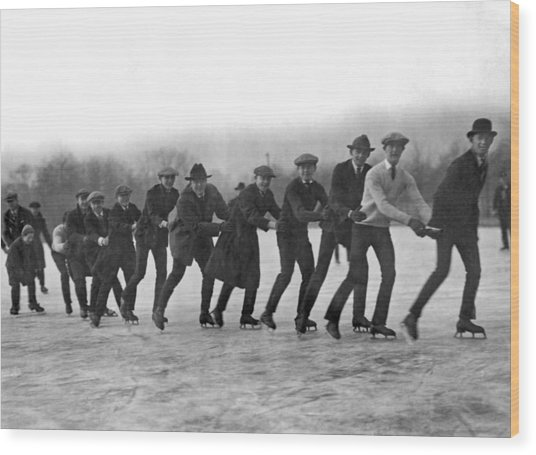 A Line Of Ice Skaters Wood Print