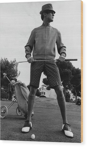 A Male Model Posing As A Golfer Wearing Wood Print by Leonard Nones