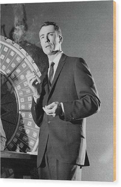 A Male Model Wearing A Dark Pinstriped Suit Wood Print by Richard Waite