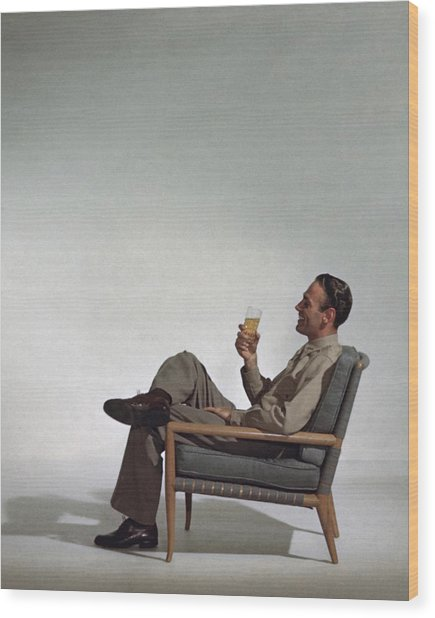 A Man Sitting In An Armchair With A Drink Wood Print
