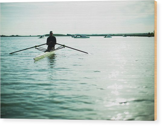 A Mature Man In A Rowing Boat On The Wood Print