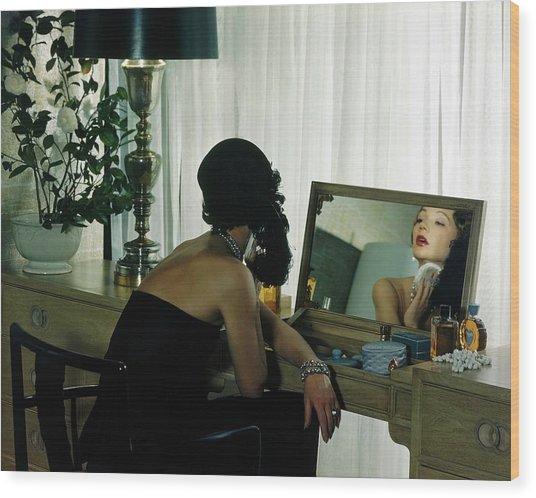 A Model Getting Ready In A Mirror Wood Print