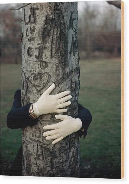 A Model Hugging A Tree Wood Print