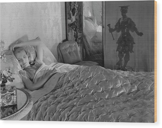 A Model In A Bed With Designer Bedding Wood Print