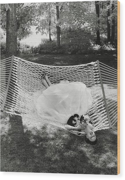 A Model Lying On A Hammock Wood Print by Gene Moore