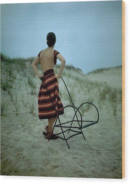 A Model On A Beach Wood Print by Serge Balkin