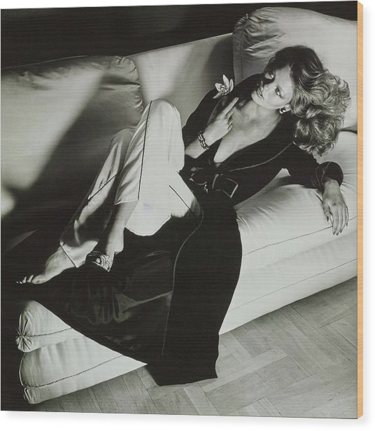 A Model Reclines On A Sofa Wearing Fernando Wood Print