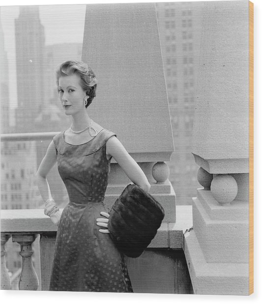 A Model Standing Against A Rooftop Column In An Wood Print