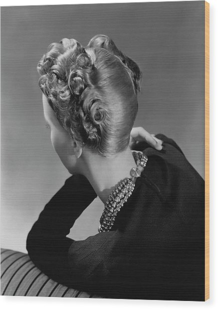 A Model Wearing A Curled Hairstyle Wood Print by John Rawlings