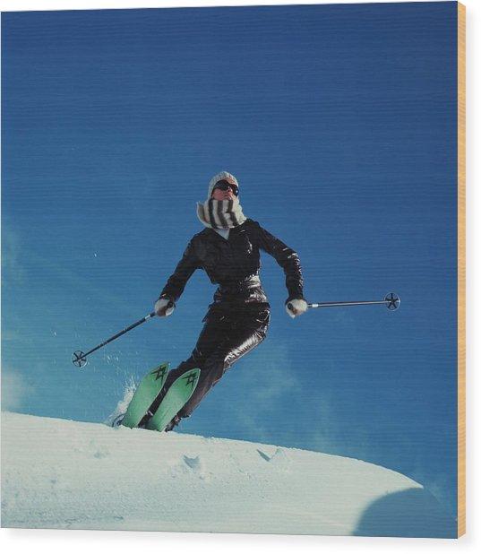A Model Wearing A Ernst Engel Ski Suit Wood Print