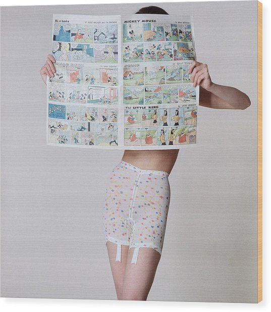 A Model Wearing A Girdle With A Comic Wood Print