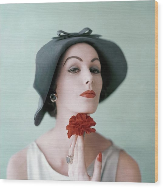 A Model Wearing A Hat And Holding A Flower Wood Print