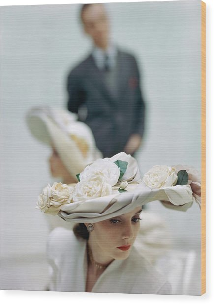 A Model Wearing A Hat Decorated With Flowers Wood Print