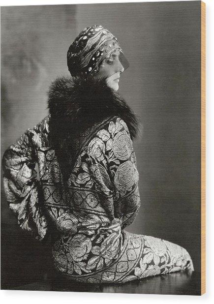 A Model Wearing A Headdress And Brocade Coat Wood Print