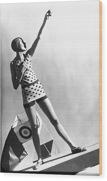 A Model Wearing A Polka Dot Swimsuit Wood Print