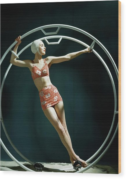 A Model Wearing A Swimsuit In An Exercise Ring Wood Print
