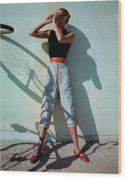 A Model Wearing A Turtleneck And Capri Pants Wood Print