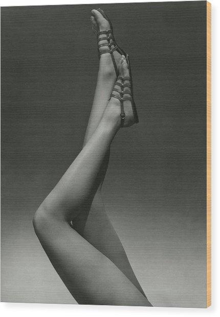A Model's Legs Wearing Sandals Wood Print