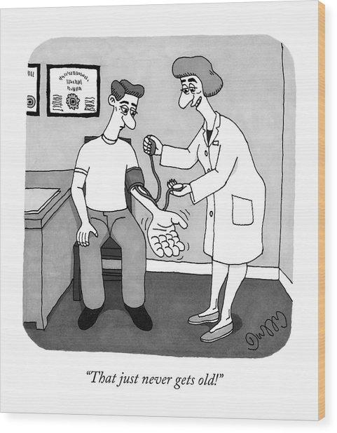 A Nurse Takes A Patient's Blood Pressure Wood Print