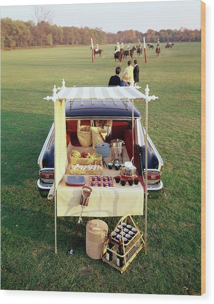 A Picnic Table Set Up On The Back Of A Car Wood Print