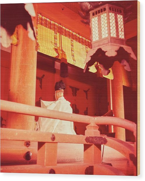A Priest Praying In A Shinto Shrine Wood Print by Nick De Morgoli