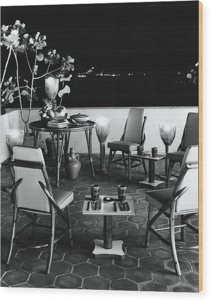 A Rattan Dining Set On A City Terrace Wood Print