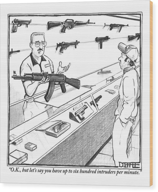 A Sales Clerk Shows Off An Automatic Weapon Wood Print
