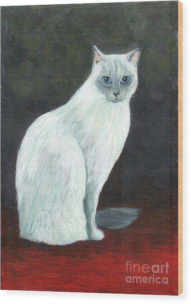 A Siamese Cat On Red Mat Wood Print