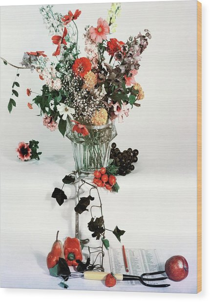 A Studio Shot Of A Vase Of Flowers And A Garden Wood Print