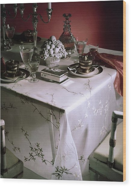 A Table Set With Delicate Tableware Wood Print