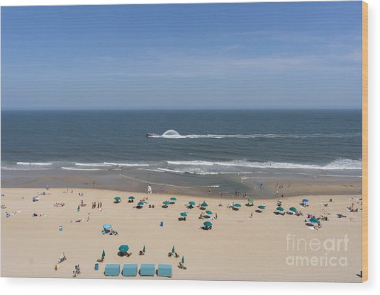 A Touring Speedboat Passes By Shore In Ocean City Maryland Wood Print