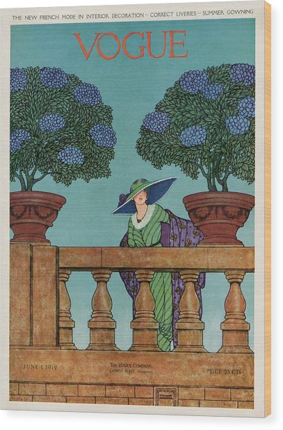 A Vogue Cover Of A Woman At A Balustrade Wood Print by Wilson Karcher