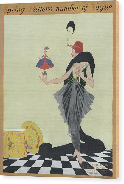 A Vogue Cover Of A Woman Holding A Doll Wood Print