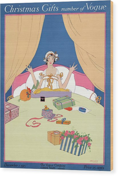 A Vogue Cover Of A Woman In Bed With Gifts Wood Print