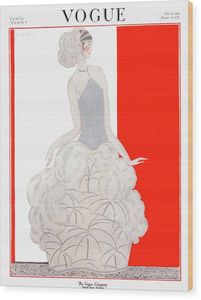 A Vogue Cover Of A Woman Wearing An Evening Gown Wood Print by Georges Lepape