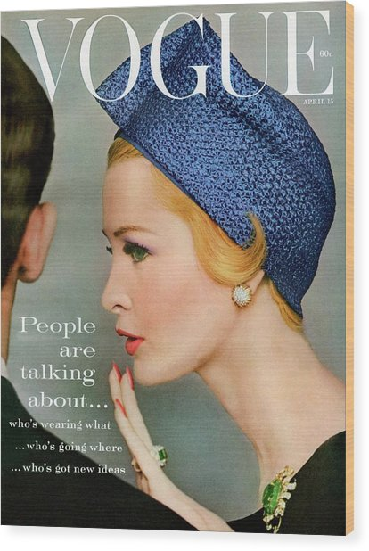 A Vogue Cover Of Sarah Thom Wearing A Blue Hat Wood Print by Richard Rutledge