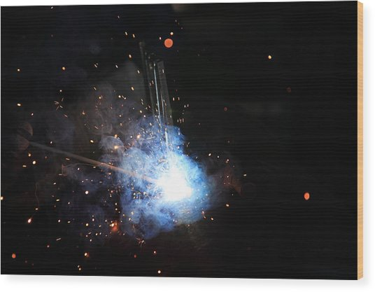 A Welder's Universe Wood Print by Daniel Alcocer