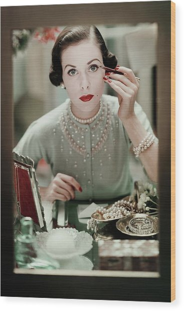 A Woman Applying Make-up Wood Print
