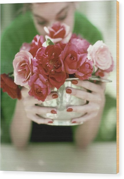 A Woman Holding A Bowl Of Roses Wood Print
