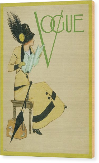 A Woman Holding A Map For Vogue Wood Print