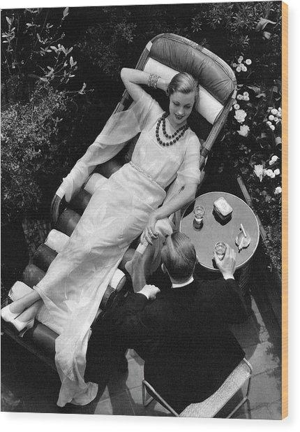 A Woman In A Chiffon Tea Gown In A Chaise Longue Wood Print